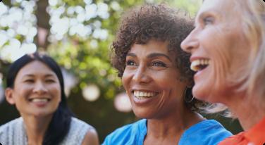 3 women smiling outside