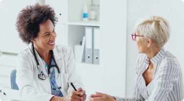 Physician and female patient engaged in a conversation