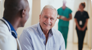 Physician and male patient engaged in a conversation